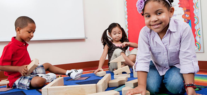 Children on floor with building blocks
